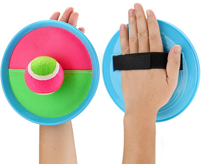 Toss and catch paddles and ball two hands shown- with the game paddle velcroed onto hand and the sticky velcro ball stuck to the paddle