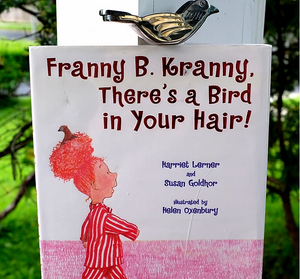 Book cover Franny B. Kranny There's a Bird in Your Hair! shows little girl with striped pajamas and bird sitting in her bun!
