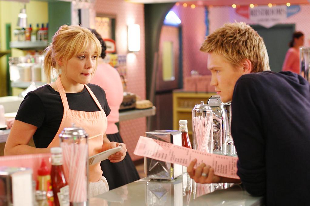 Hilary Duff in scene from movie A Cinderella Story waitressing in diner taking order from cute teen boy