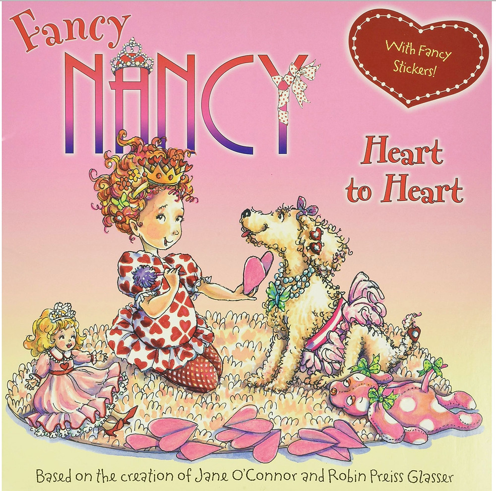 Fancy Nancy Heart to Heart book cover shows little girl holding a valentine with a dog and dolly sitting on the rug next to her
