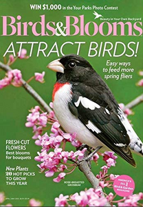 bird sits on a pink flowered branch magazine cover from Birds and Blooms