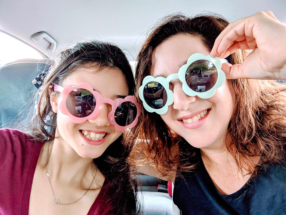 mother and daughter wearing flower shaped sunglasses