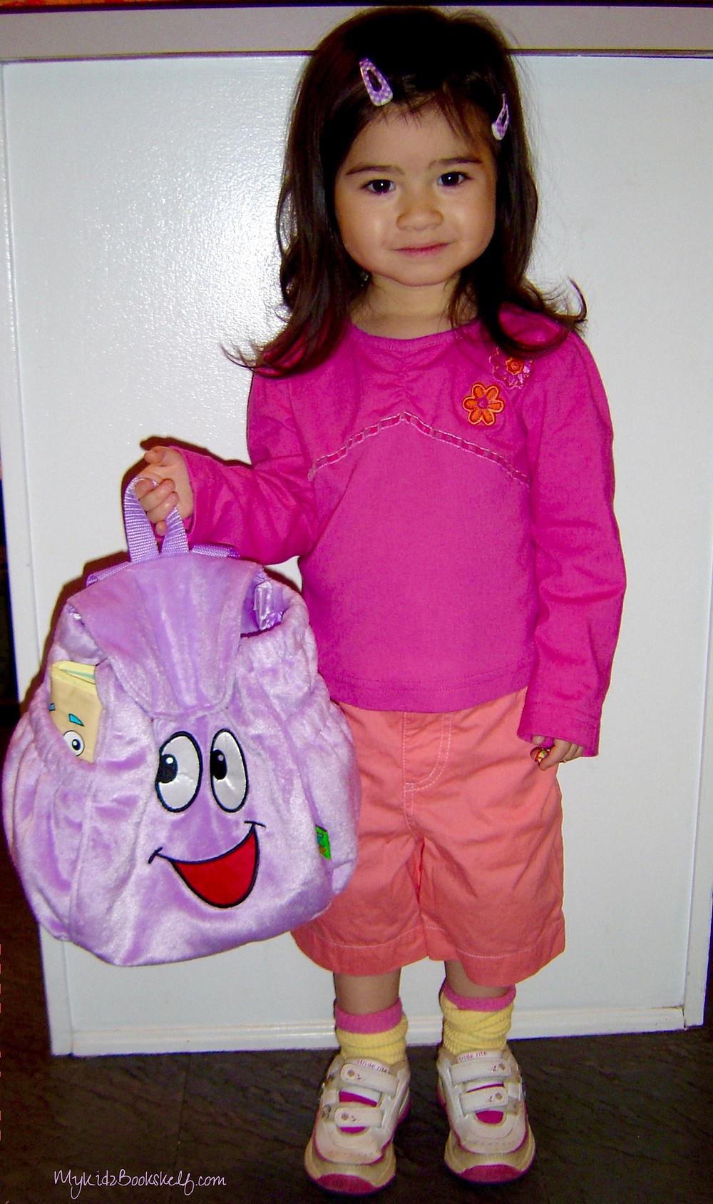 little-girl-dressed-in-halloween-costume-as-Dora-the-explorer