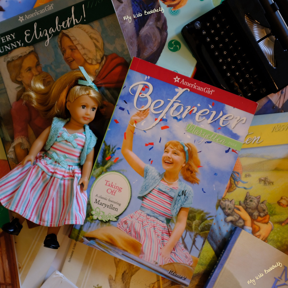 American-girl-doll-Mary-Ellen-next-to-American-Girl-Doll-books-with-toy-typewriter-in-the-background
