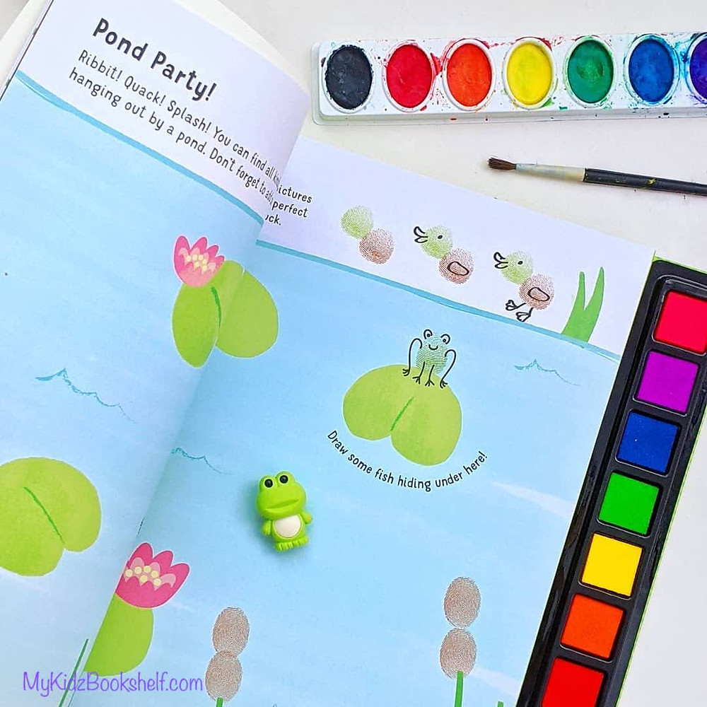 Fingerprint friends by Insight Editions book and ink pads set with other art supplies in picture