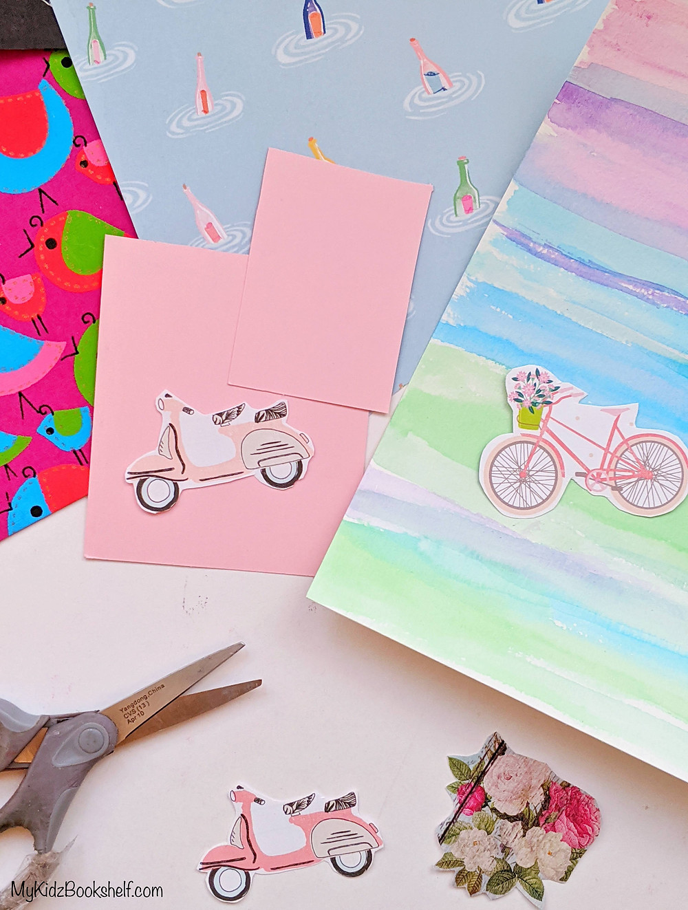 DIY collage craft shows scissors with cutout images of mopeds and flowers