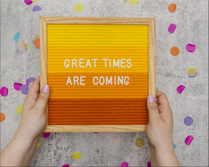 Felt Letter Board spells out Great Times Are Coming is one of our Graduation Gift Ideas