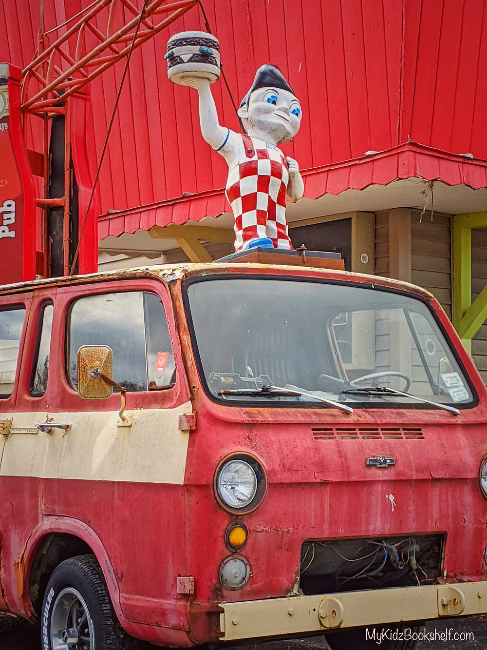 Currently Bookmarked old red van with vintage statue of boy in checked overalls holding a double burger