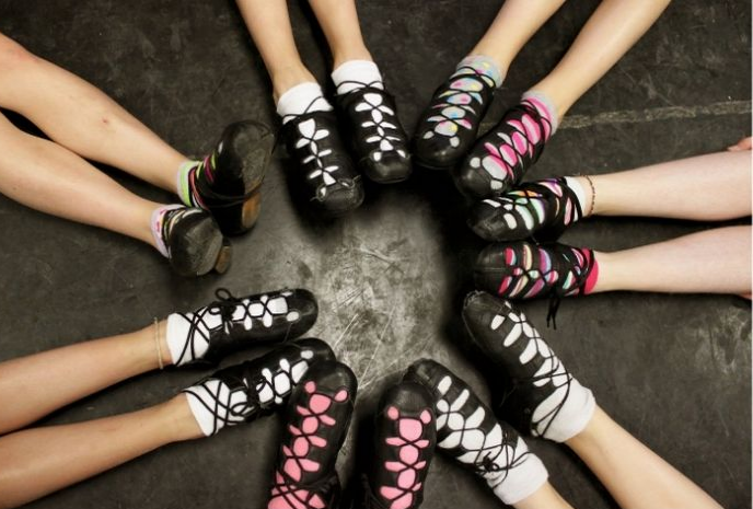 Irish step dance shoes girls sitting in circle only shoes showing