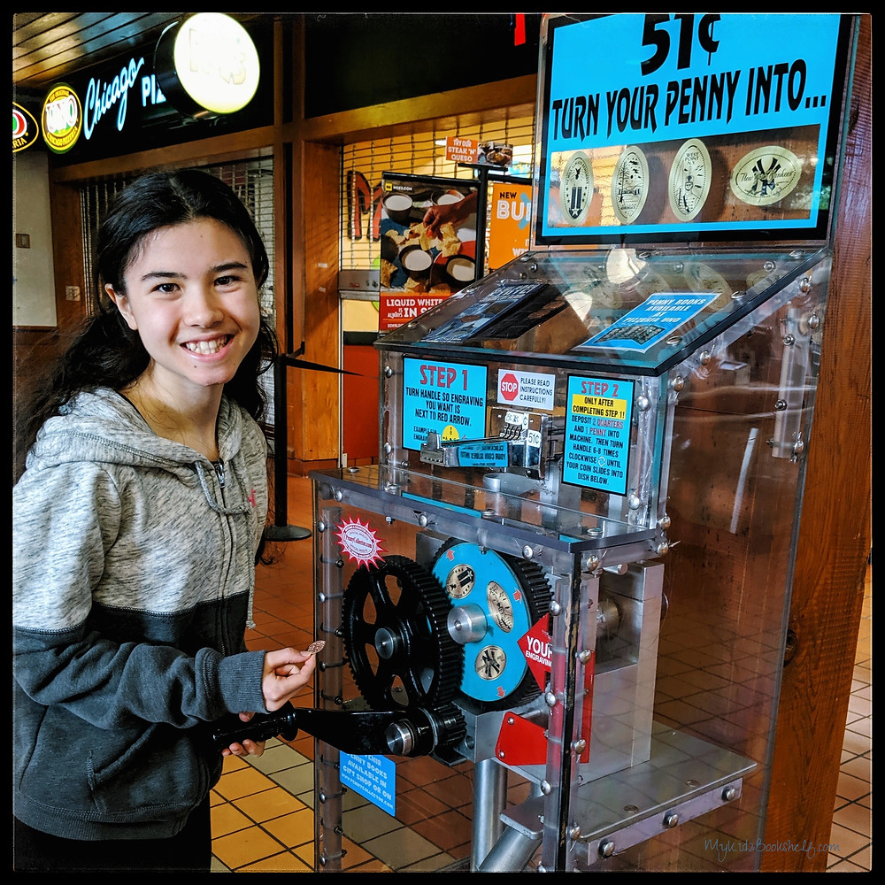 girl-with-penny-smashing-souvenir-pressed-penny-machine