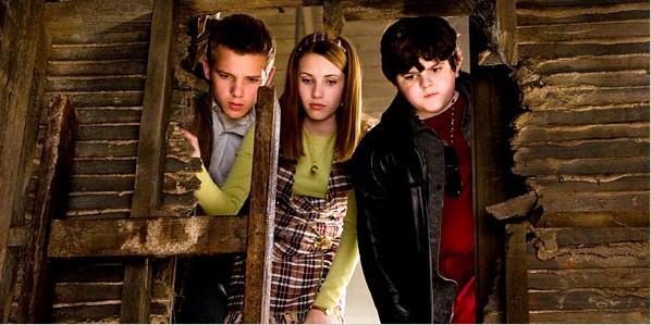 Nancy Drew movie with Emma Roberts good Halloween movie kids looking behind wall