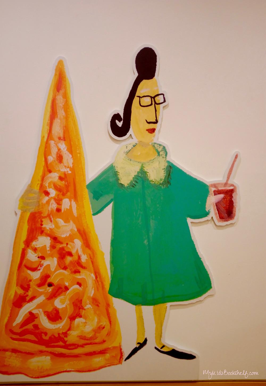 Maira Kalman illustration with woman holding a pizza slice