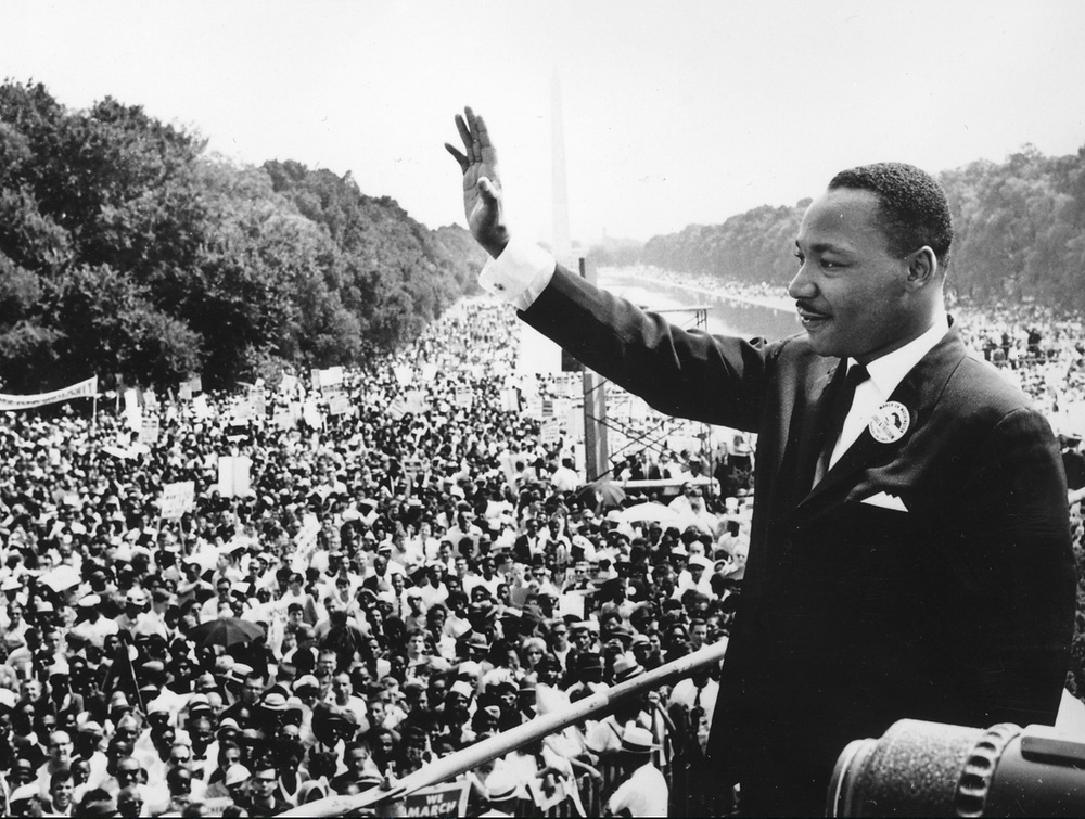 Martin Luther King waving to crowds in Washington D.C. at this speech