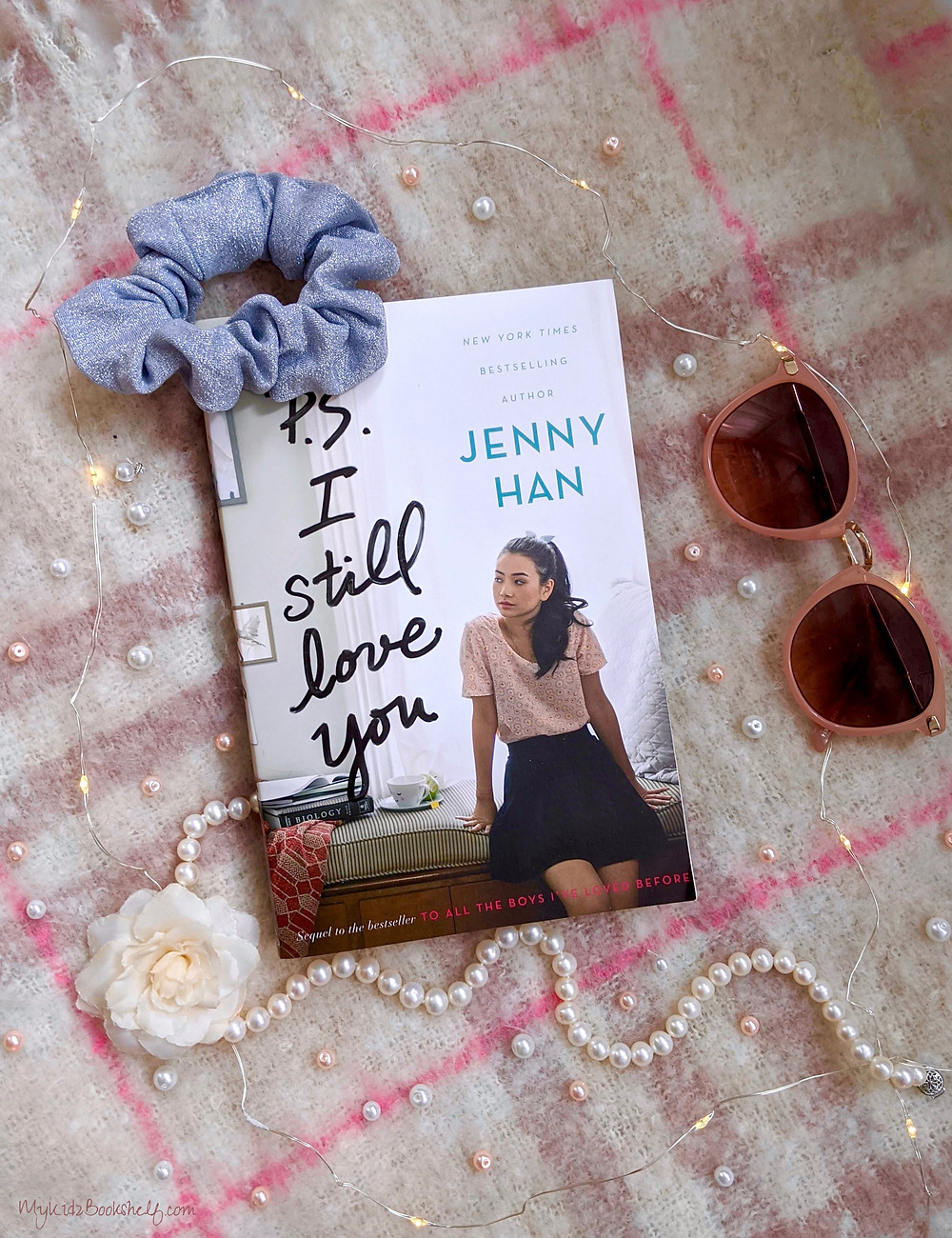 P.S. I still love you by Jenny Han book cover with scrunchie, sunglasses, pearls