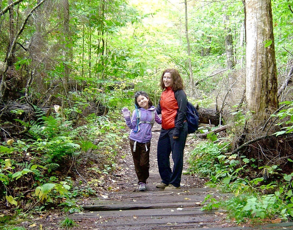 mother-and-daughter-hiking-in-the-woods