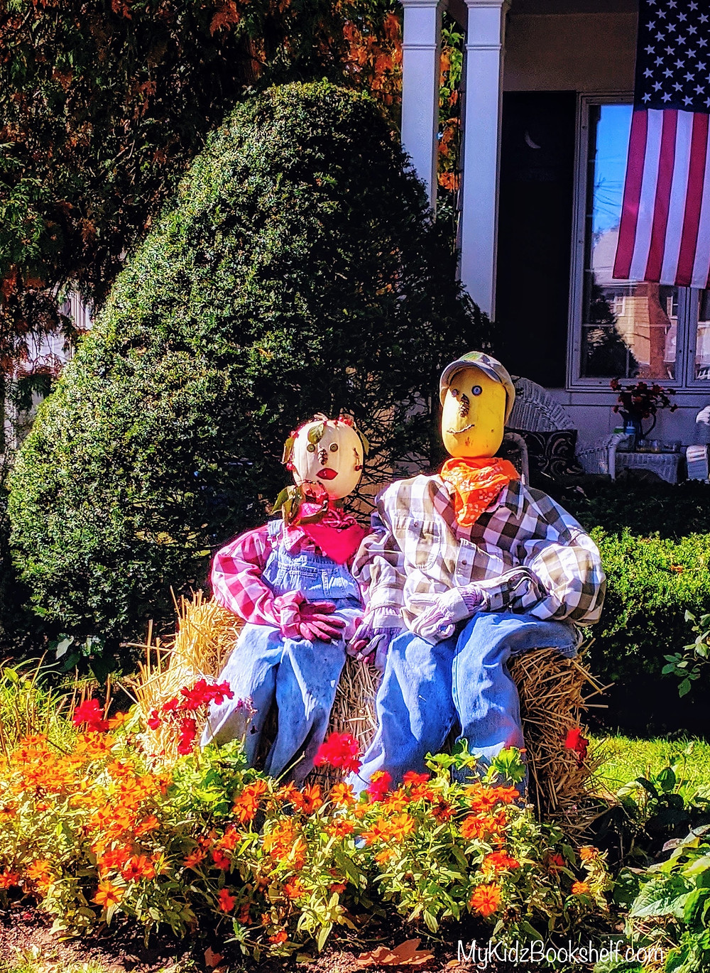 Scarecrows sitting in front of house