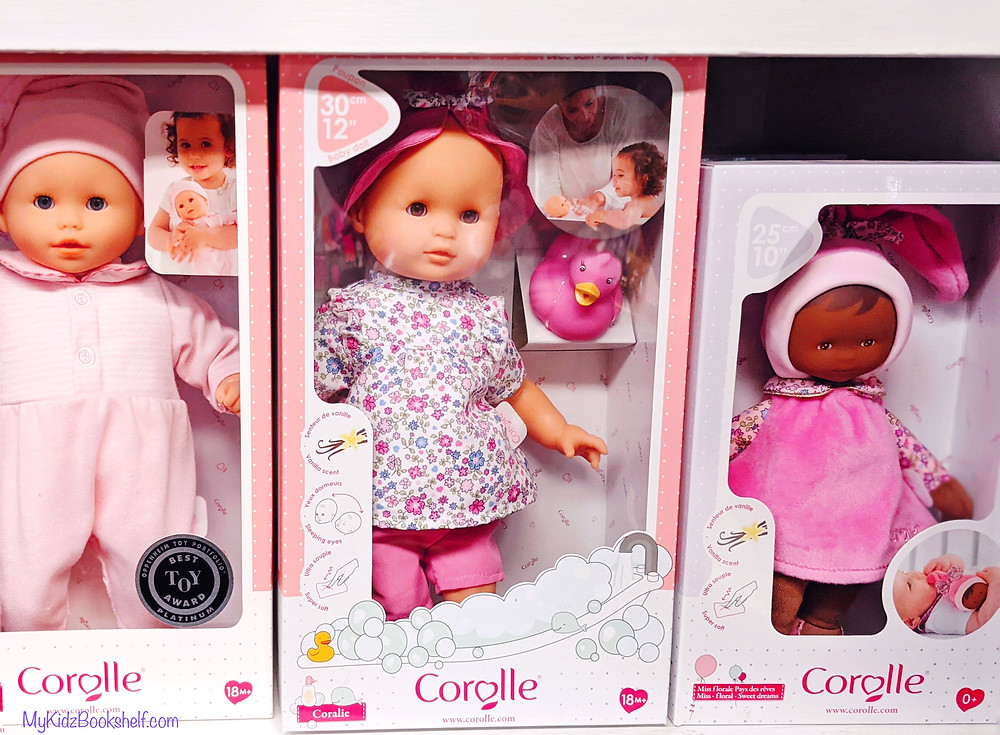 Baby dolls in boxes on shelf from Corolle