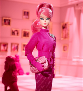 Mattel's 60th Anniversary Proudly Pink Barbie dressed all in pink with pink hair, pink dress and pink clutch