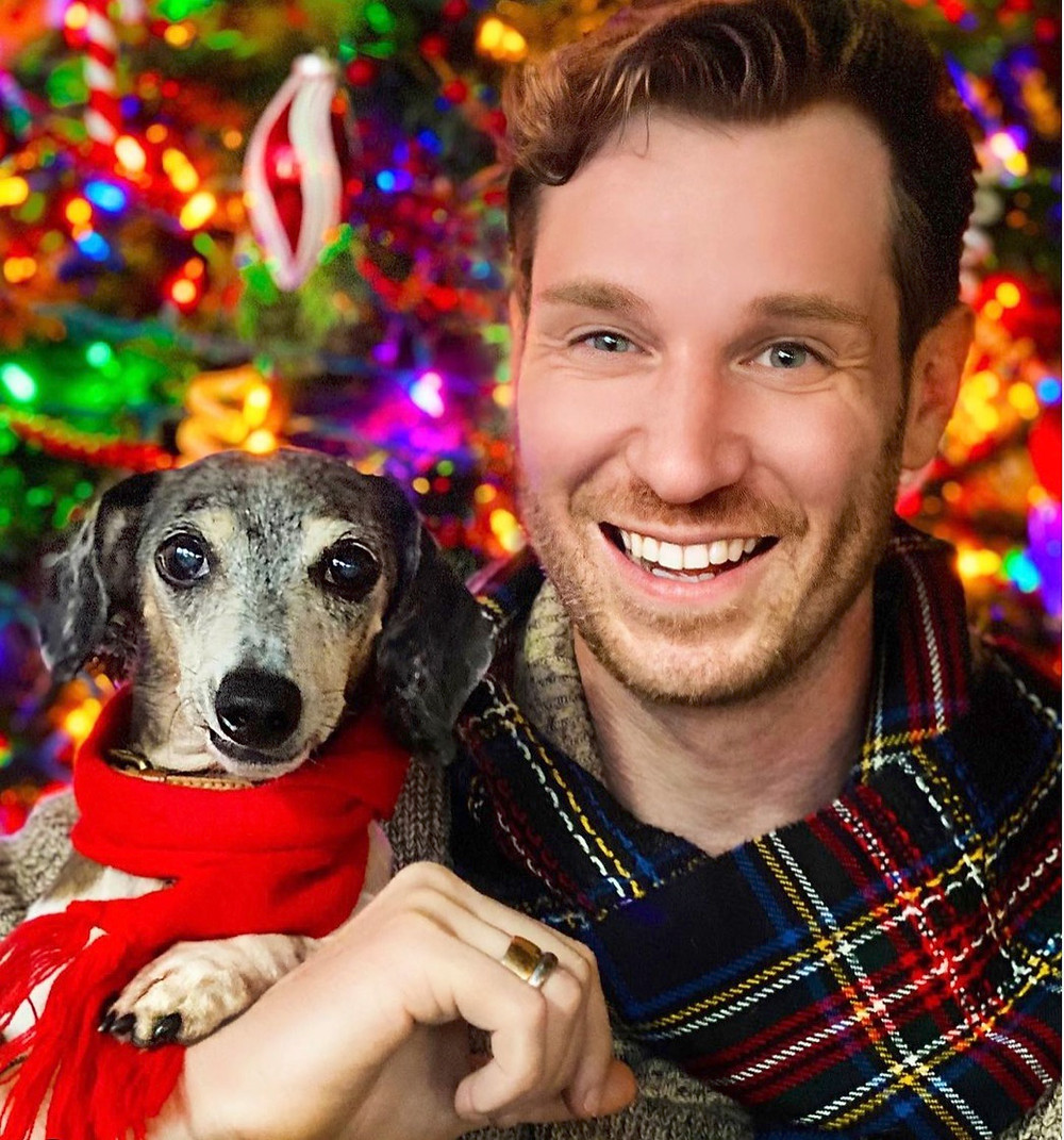 Oliver Gilmore the dog with Greg McGoon in Christmas photo