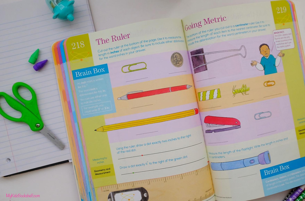 Brain Quest notebook opened up to middle showing measuring