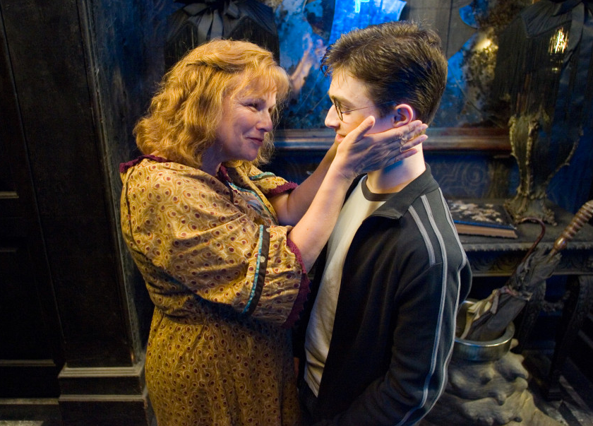 Mrs. Weasley and Harry Potter from Harry Potter movie starring Julie Walters and Daniel Radcliffe