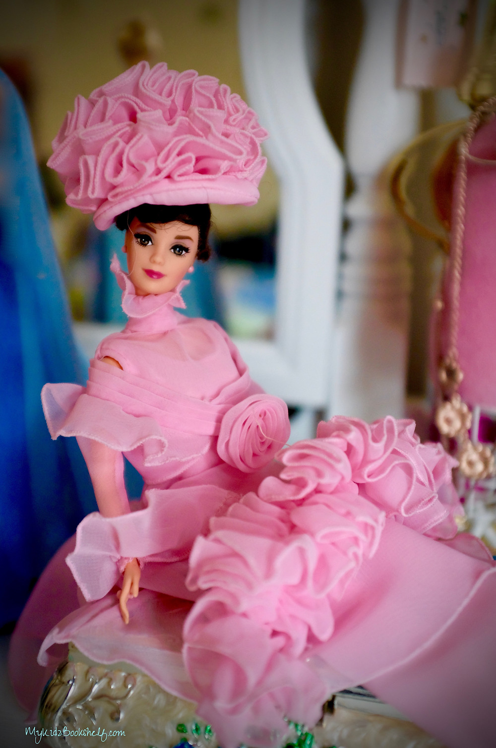 Barbie Doll limited edition of Audrey Hepburn dressed up as Eliza Doolittle from the movie, My Fair Lady. She is wearing all pink outfit and hat from one of the scenes in the movie.