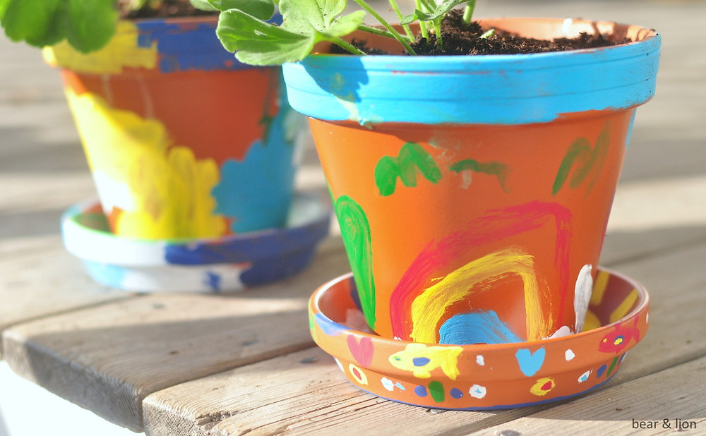 painted flower pots with painted rainbows and flowers for Mother's Day