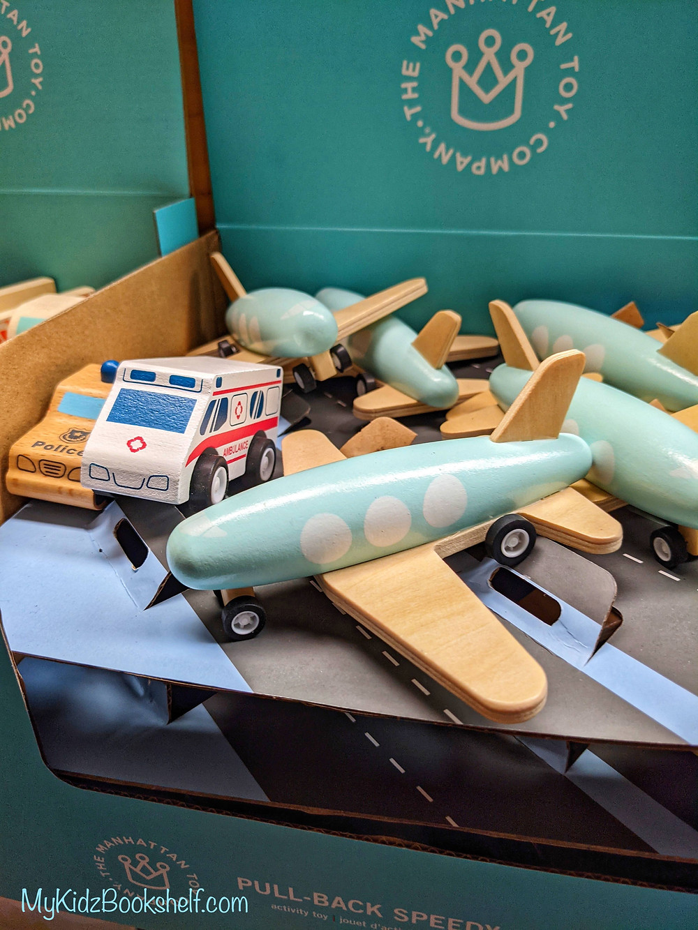 The Manhattan Toy Company Speedy Plane pull back wood toy