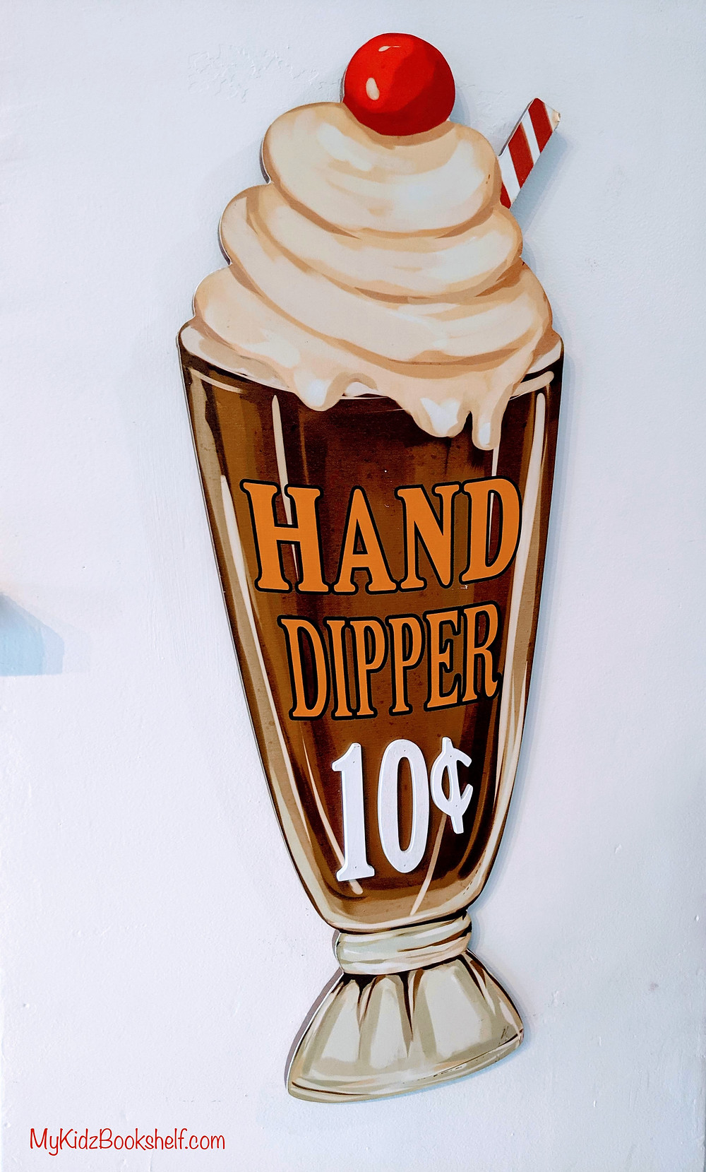 vintage ice cream sign that says 'Hand Dipper - 10 cents