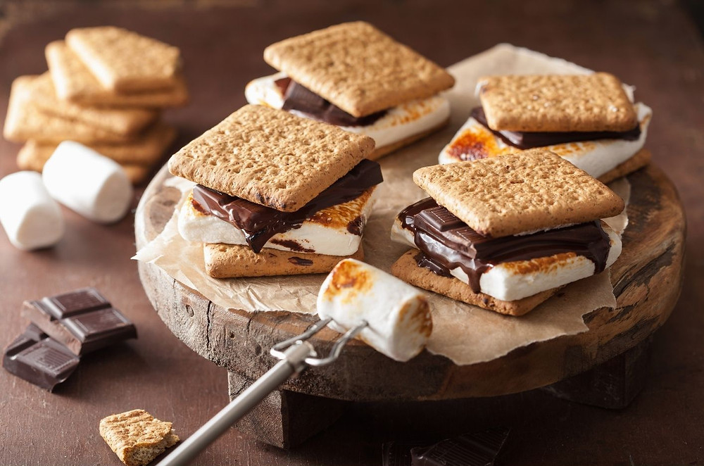 s'mores made from toasted marshmallow, graham crackers and chocolate bars