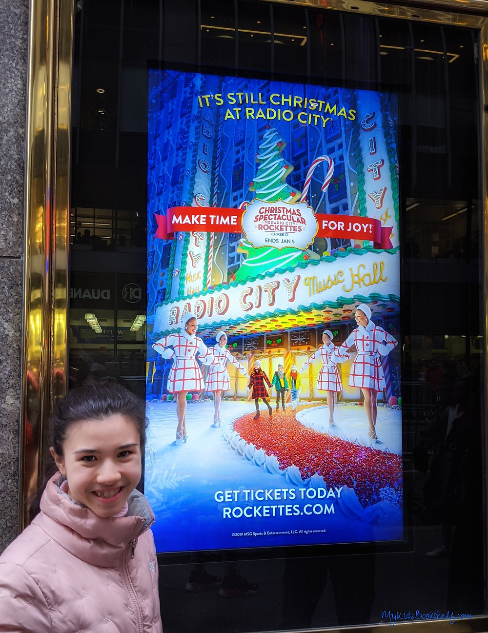 teen-girl-posing-next-to-the-Radio-City-Rockettes-poster