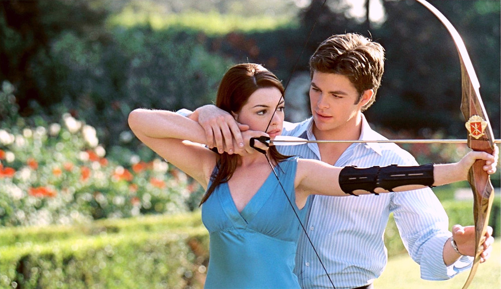 Princess Diaries 2 The Royal Engagement with Ann Hathaway and Chris Pine practicing archery