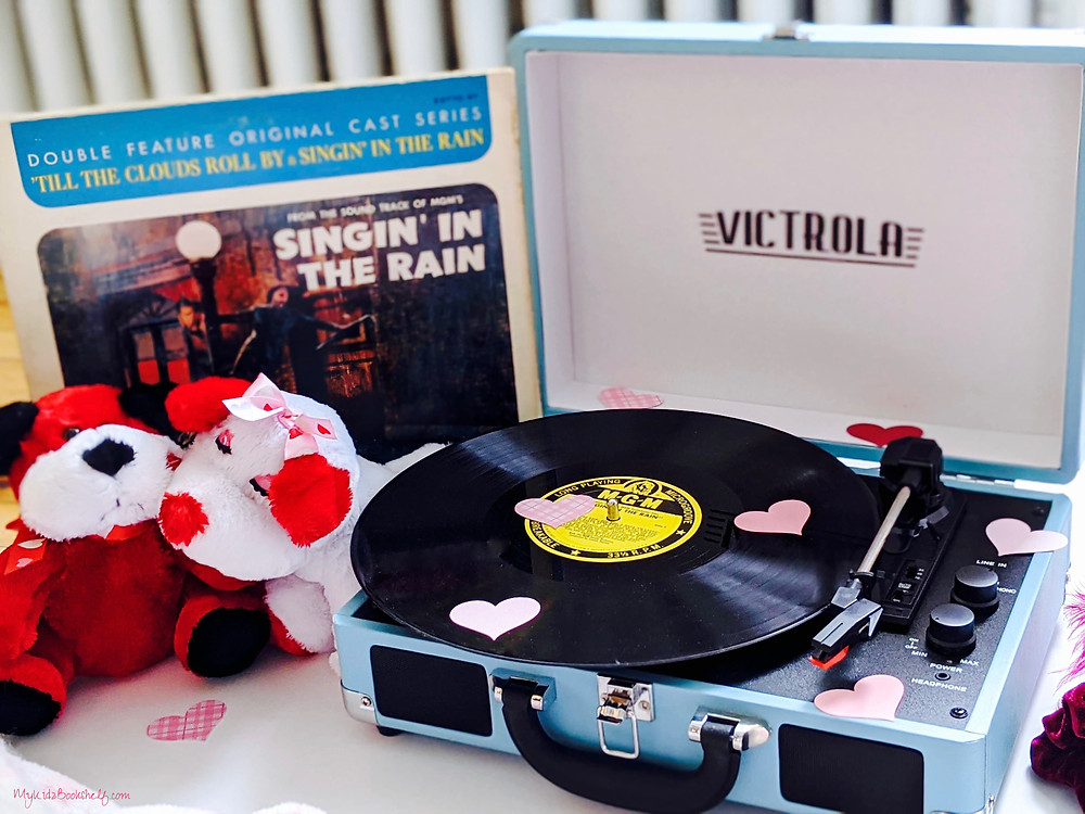 Victrola record player with Singin In The Rain Record