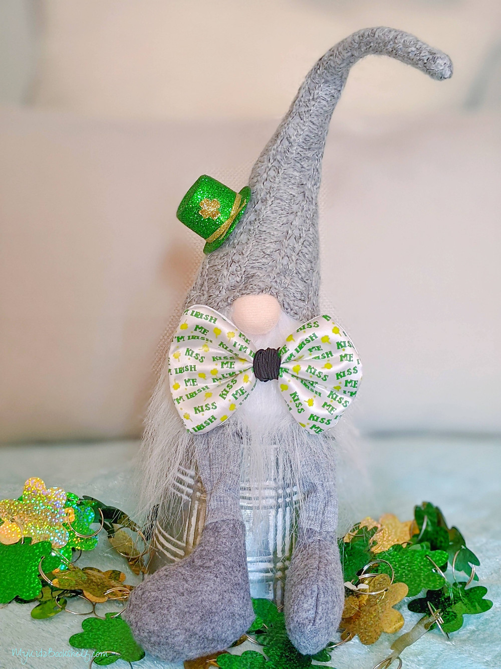 gnome with bowtie and green mini sparkly Irish hat surrounded by green clovers