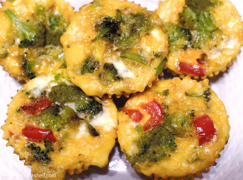 Muffin Tin Egglettes -A Mini Crustless Quiche Recipe! shows mini cupcake sized quiche with broccoli and red peppers on a plate