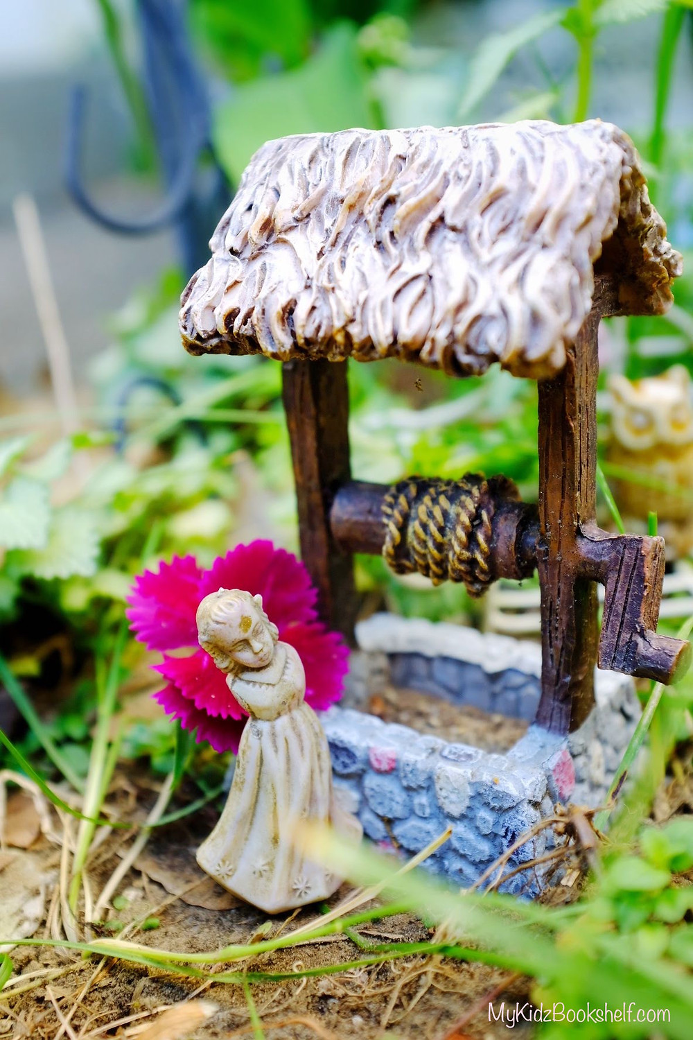 fairy garden wishing well miniature with little angel figurine and flower