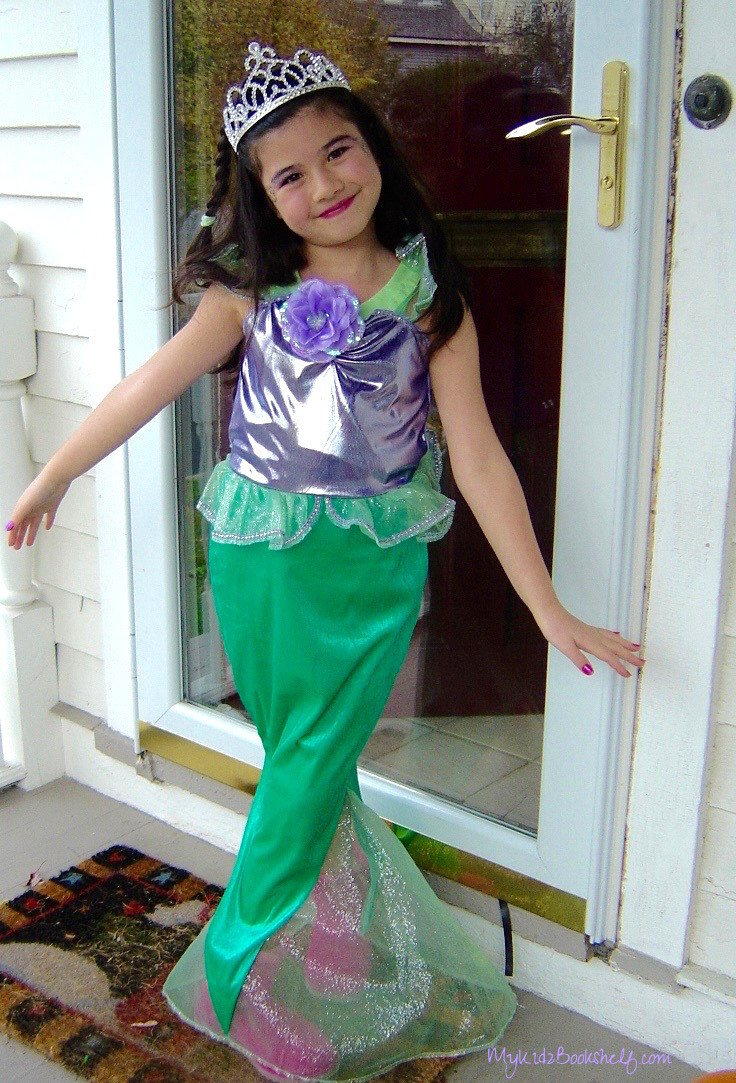little girl dressed up as a mermaid for Halloween