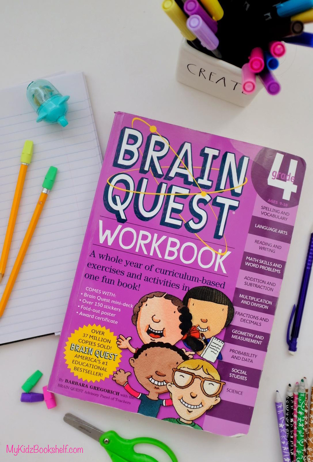 Brain Quest workbook for grade 4 with pencils, sharpener and paper