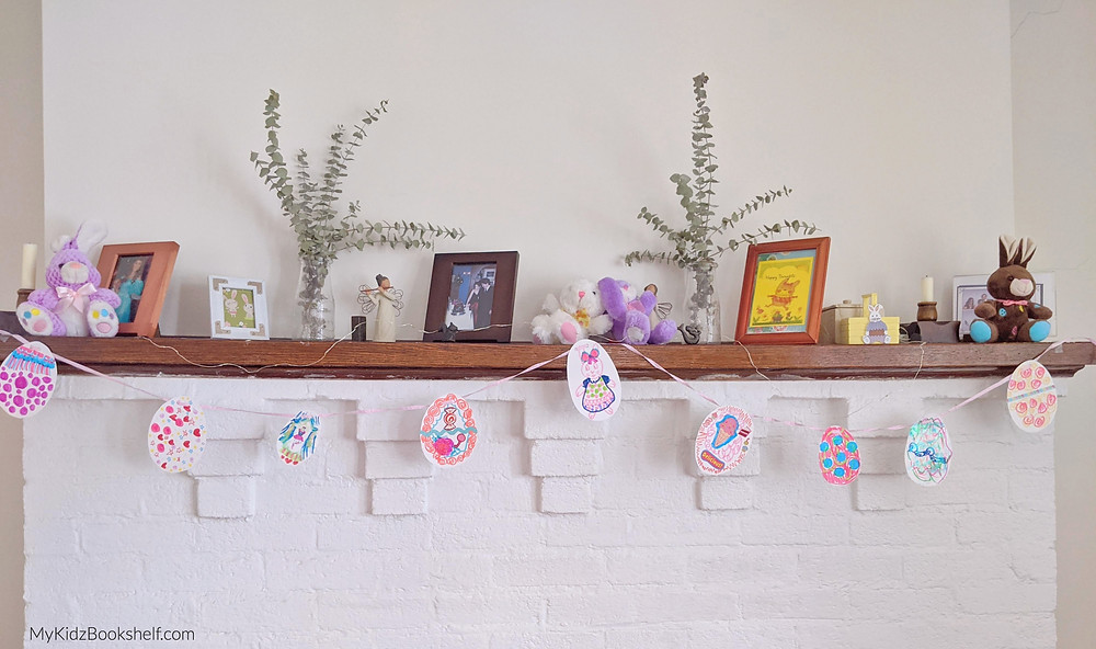 egg garland and bunnnies on fireplace mantle easter decor