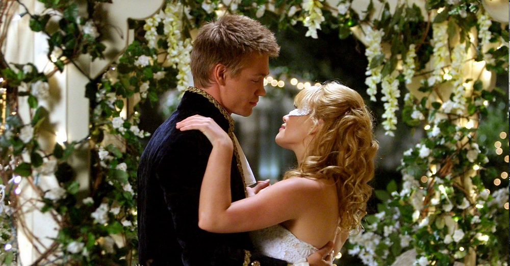 Hilary Duff in a Cinderella Story dancing with young man surrounded by flowers and vines