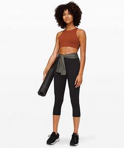 Woman wearing fitness attire leggings, sports bra Great Gifts for Grads