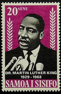 postage-stamp-with-picture-of-Martin-Luther-King-Jr-speaking-into-microphones