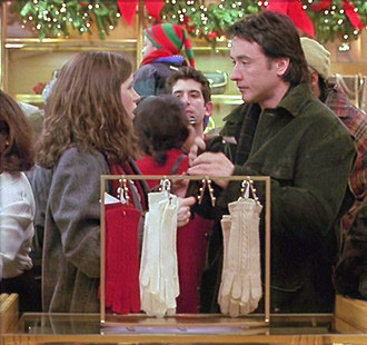 man-and-woman-looking-at-each-other-over-glove-rack-in-department-store