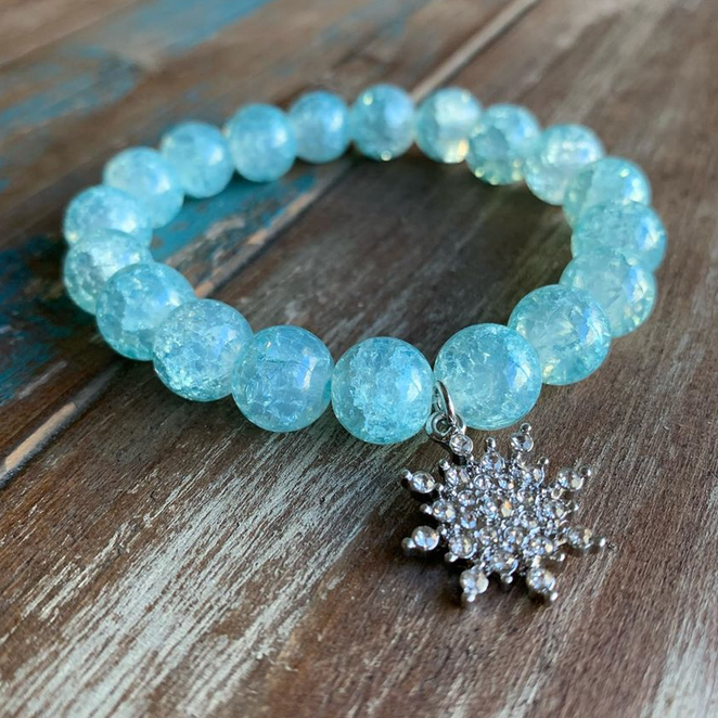 blue-beaded-bracelt-with-Frozen-style-snowflake-dangling-charm
