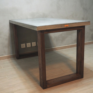Custom-made concrete dining table