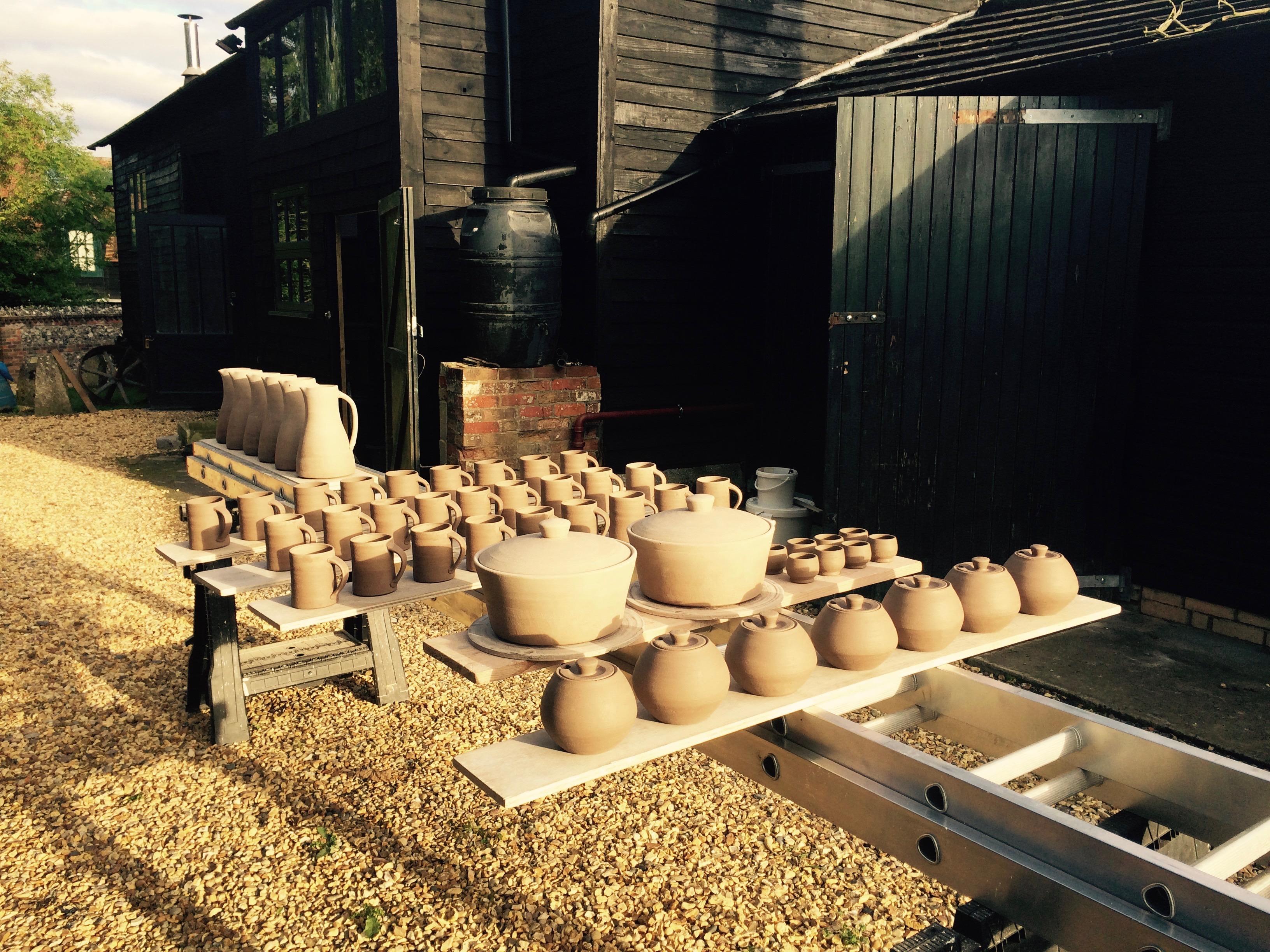 pots drying outside the studio