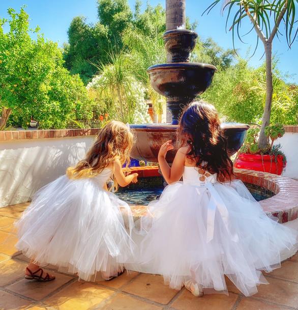 Flower girls at Luna Bella Ranch fountain