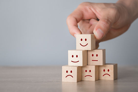 Wooden cubes with smiling faces for customer feedback
