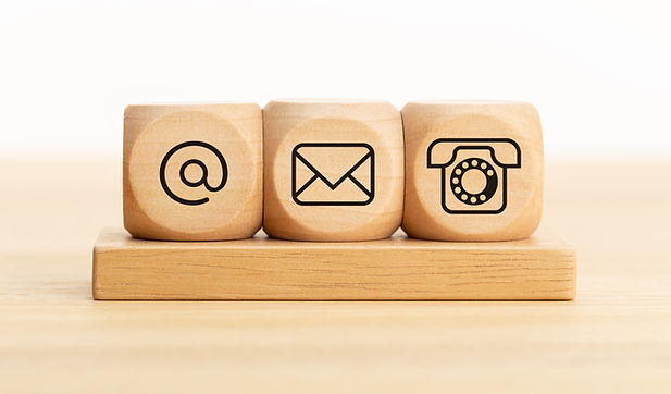 wooden cubes showing how to contact us by email phone or online