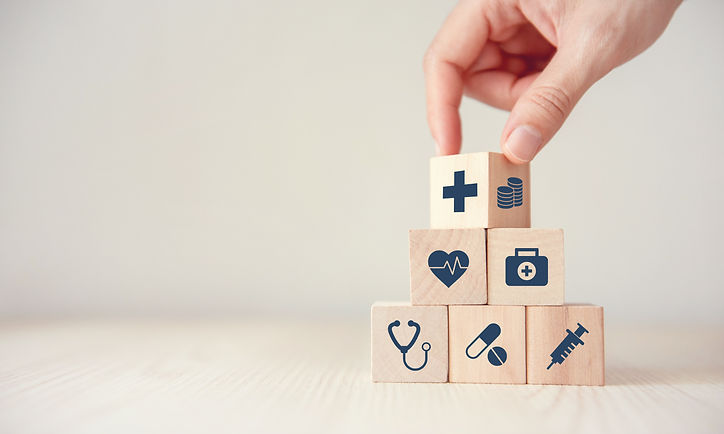Wooden cube with medical icons including medical insurance